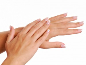 Gesturing of woman hand. Skin-care. Female arms
